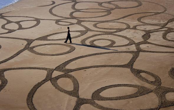 sand art,andres amador,disegni,spiaggia,sabbia